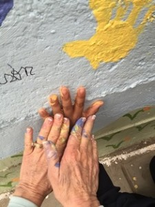 In Peru, making schoolyard wall handprints.